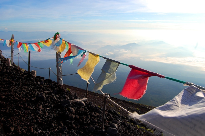 Flags on top of Mount Fuji Photo by Claire Oberst