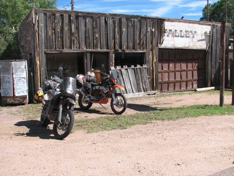 Love pics of bikes and old structures.