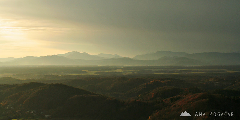 Looking toward the west from a hill above Kamnik one can see rolling hills and mountains in the background.