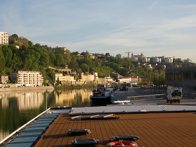 Parked on the Saone in Lyon; goodbye Rhone.  Sun deck; rails lowered for low bridge when we leave.