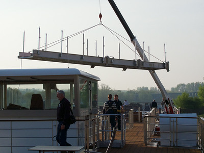 Hoisting and stowing the gangplank.