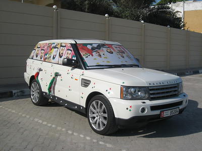Local guys decorate their cars with pictures of the local rulers, hearts, stars etc.  How they see out of the windscreen is an unanswered question though.  I took this photo in Abu Dhabi without realising that the building behind was a military college.  The security soldier chased after me and gave me an agressive mouthful in Arabic (I was ready to get out the mobile and call Rasha for help).  He demanded to see my photos but when he saw that I'd only taken photos of the car, his whole attitude changed.  His face broke into a huge smile, he looked at the photos a couple more times then handed the camera back to me, laughed and wandered off.