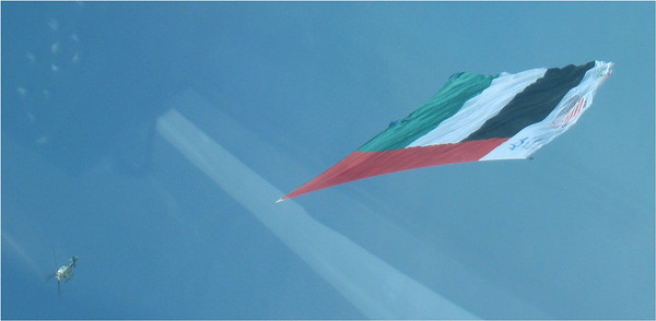 "The UAE flag which now holds the title of ""world's largest banner"",  Its 50,000 square feet in size and was towed under a Bell 412 Aircraft,  The flag was clearly visible from up to 20 kilometers away and the route was specifically designed to take the flag right across the capital making it visible to virtually the entire population of the city of Abu Dhabi."