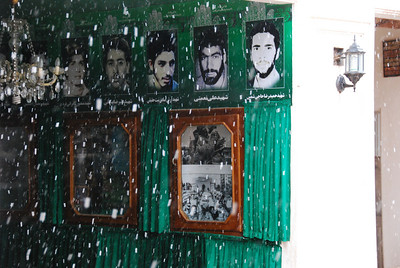 The Zeyaratgah shrine through the falling snow.  The photos are of local men who died in the Iran-Iraq war.