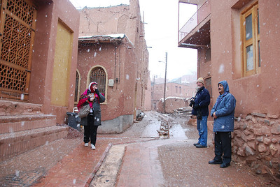 Jess, Colin and Hushang in the snow at Abyaneh.