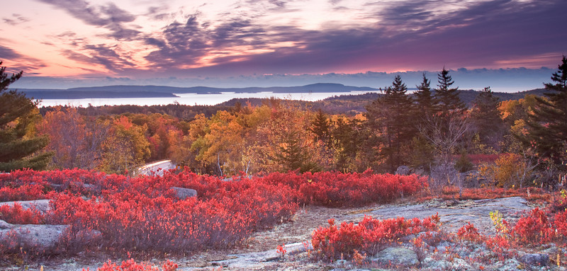 This shot is the same sunrise as the previous shot.  I have a different vantage point.  The harbor in the distance is Bar Harbor.  Within 15 minutes after setting up my equipment, this area was covered with other photographers.