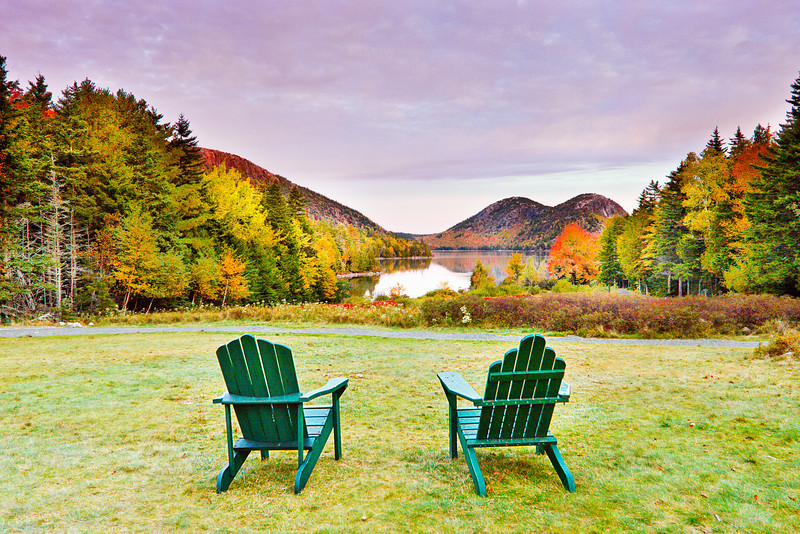 This is another view from the lawn of Jordan Pond.  Behind these chairs is a restaurant and outdoor picnic area.  When the park was first established, there was a farmhouse here.  The owner would offer picnic lunches to travelers.  The picnic area still exists, but the old farmhouse was destroyed by a fire.  It has been replaced by this very nice restaurant.  My wife and I ate on the lawn and had tea and hot popovers.  The popovers are wonderful!