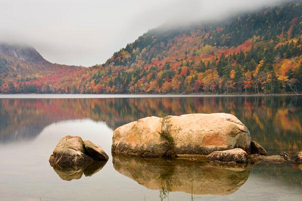 An early morning fog hangs over Jordan Pond.