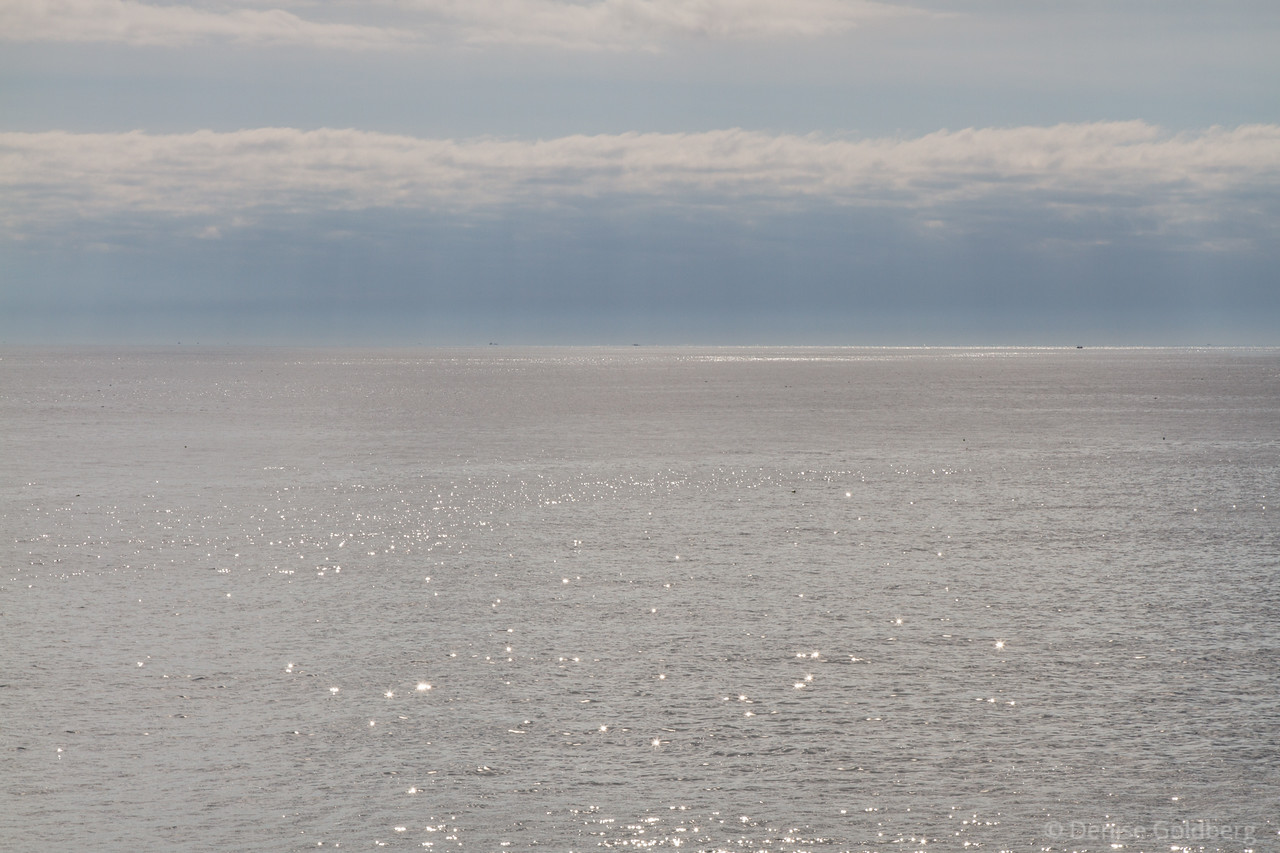 shimmering sea with cloud decorations