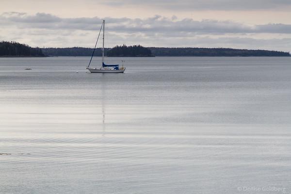 a lone sailboat