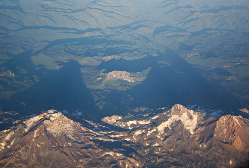 Phantom Peaks<br /> From the airplane flying over Oregon or Washington?  I don't know what the mountaintops were, but I thought they looked cool!