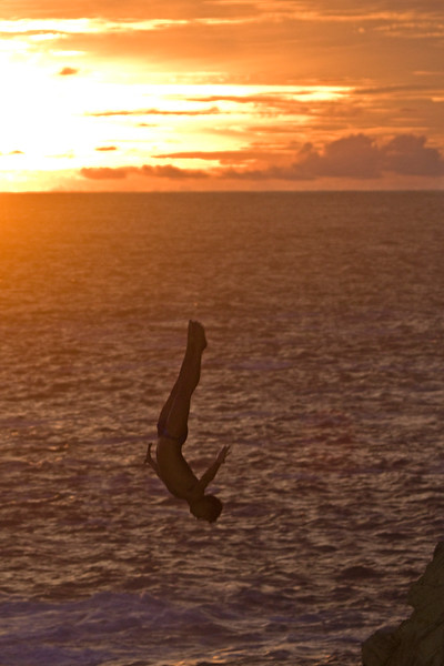 Perfecto Mundo!<br /> <br /> These cliff divers put on a show every night, starting at sunset.  It was so amazing to watch!