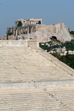 Acropolis of Athens, Greece  The Acropolis of Athens is an ancient citadel located on a high rocky outcrop above the city of Athens and containing the remains of several ancient buildings of great architectural and historic significance, the most famous being the Parthenon.