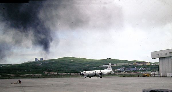 Smoke from the exercise drifts over one of the P3C Orion aircraft