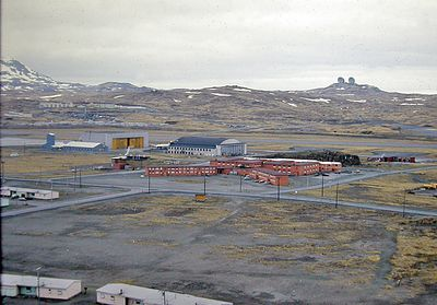 """Looking at the Birchwood Barracks from Water Tower Hill. The real name of this hill is """"Norpac Hill"""" but the CB'ers on the Island knew it as Water Tower Hill. (I'm standing beside the huge water tank when this photo is taken). Behind the barracks, the AIMD Hangar...the VP Hangar is to the left of it. In the far background, the White Alice microwave towers."""
