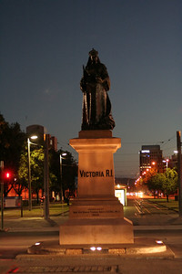 Statue in Victoria Square, with the tram station behind.