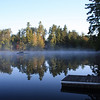 As the fog dissipates, the sail boat appears - 7:00am on a very cold morning (in the 20's)<br /> Spitfire Lake, Lonetree Camp, Adirondack Park, Paul Smiths, NY