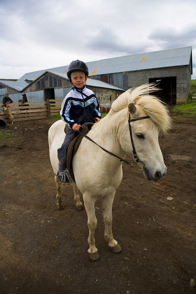 Young boy on a horse.