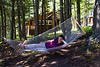 Darcie tries out the hammock at the Galbraith cabin.