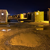 Shipping containers, used for laundry facilities and storage, are found throughout the residential areas.