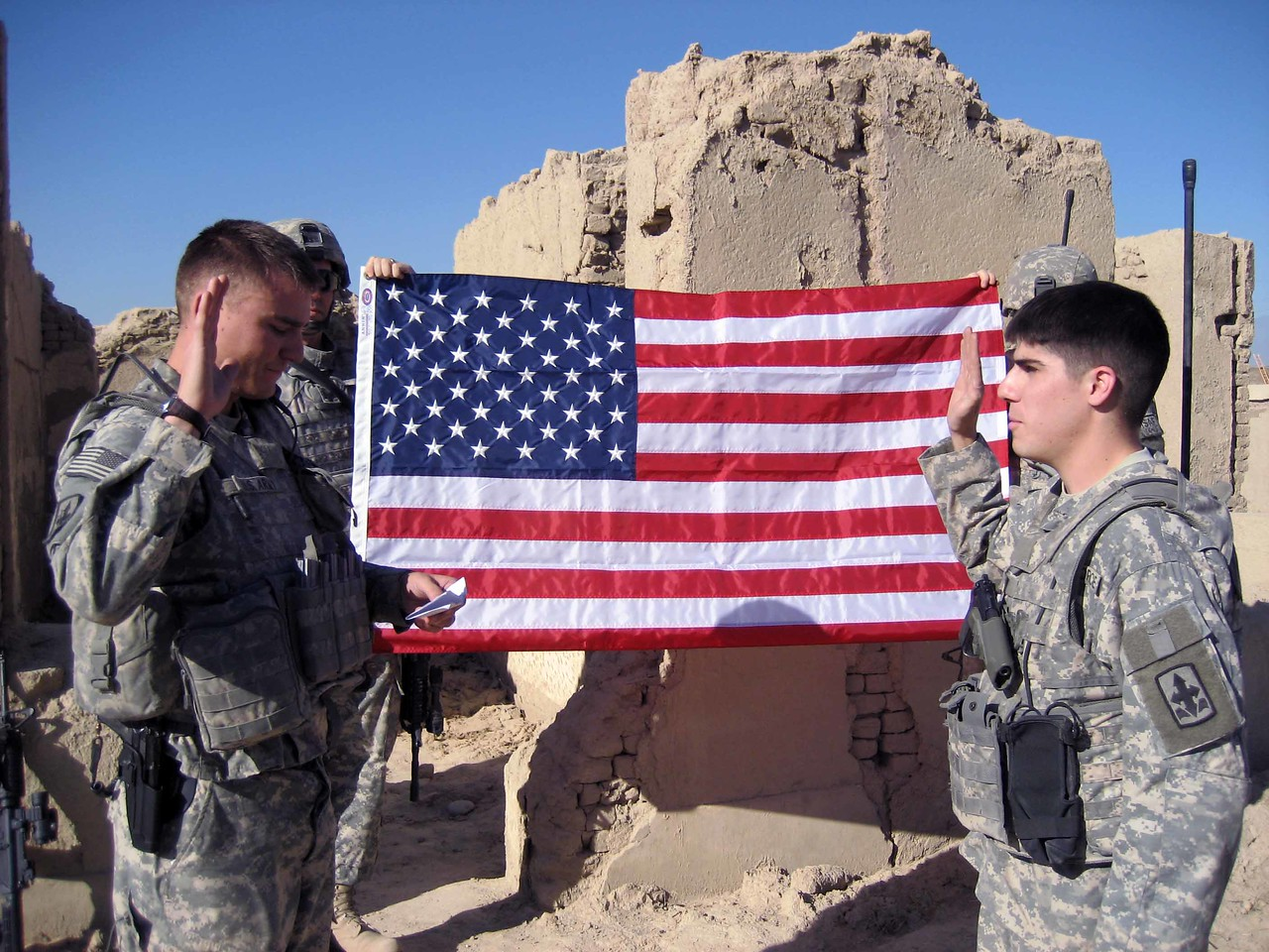 Rob Shuman's re-enlistment in front of the American Flag with Lt Auman.