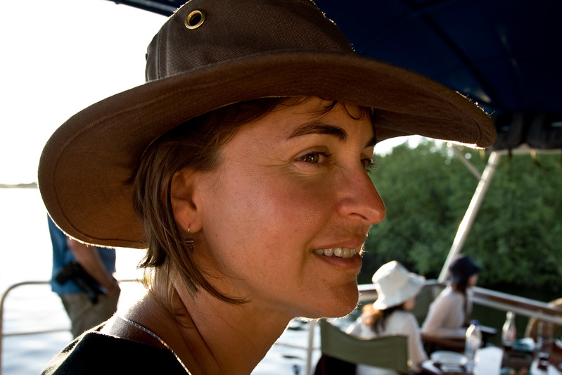"April Piston in her ""million dollar hat"" on the Zambezi River March 2006.  (born 26 April 1962; died 13 December 2006)"
