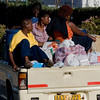 A family returns home to Zimbabwe after grocery shopping in Botswana