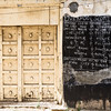 Next to a typical Stone Town door, we came across this strange sight of a chalkboard on a wall with British soccer scores on it.