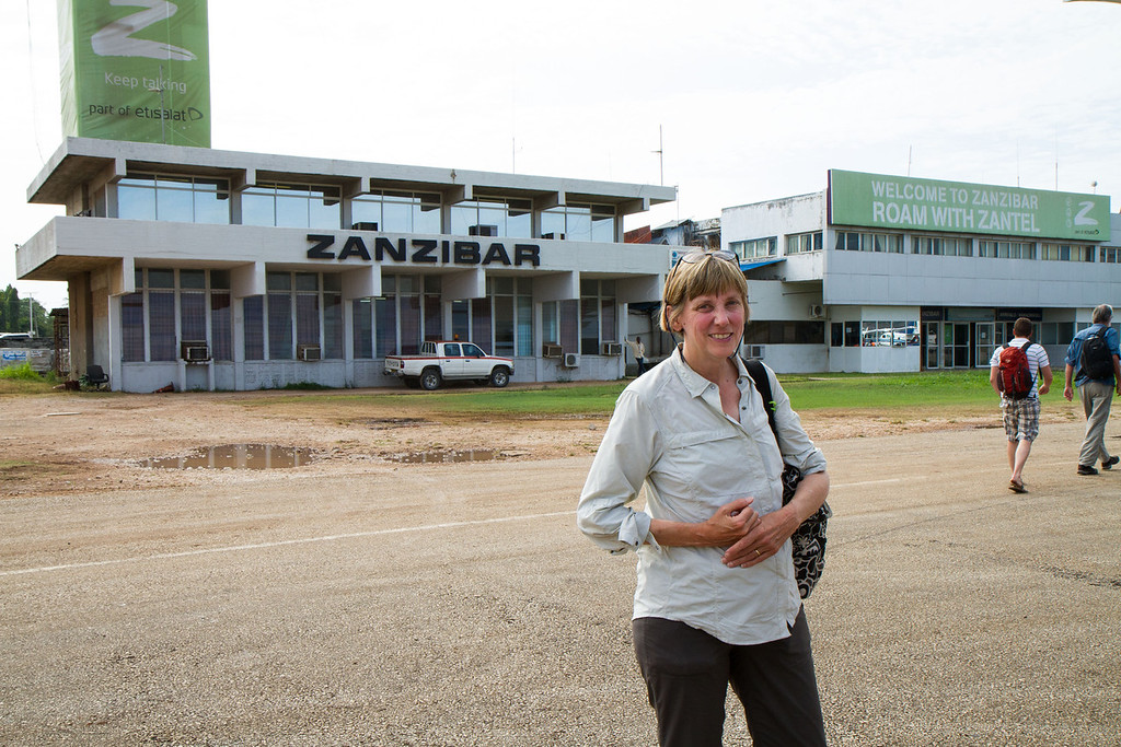 After another (larger plane) 1.5 hour flight, we landed on the island of Zanzibar, for 3 days. Here is Barbara in front of the terminal