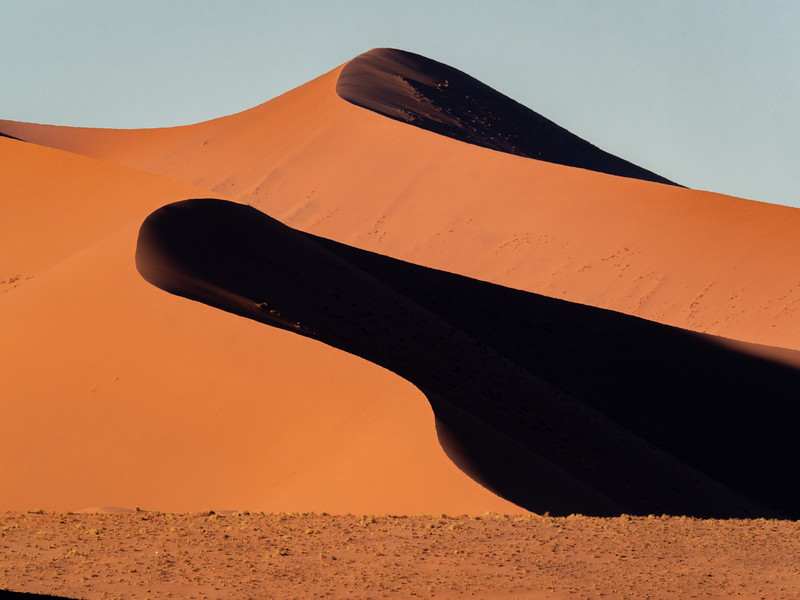 The shadows on the dunes offer dramatic views.