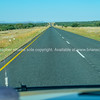 Long Namibian road stretches out ahead of car
