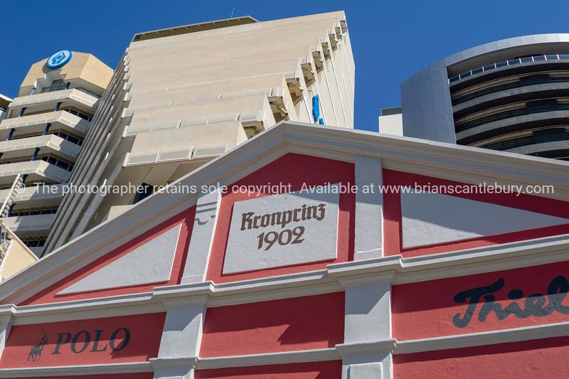 Kronprinz building facade below modern high-rise,
