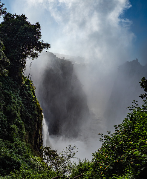 The mist forms when the cascading falls collide with the rocks below.