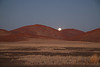 Full moon setting over the sand dunes as we enter Sousous Vlei, Namibia