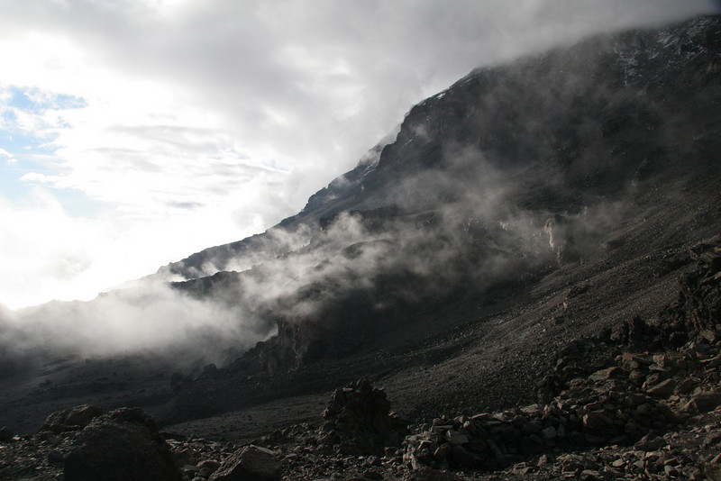 Clouds formed daily on Mt. Kilimanjaro between 3000 and 5000m, which is also where one spends most of the climb.  Clouds drifting in and out in this case gave the volcano the illusion of steaming.