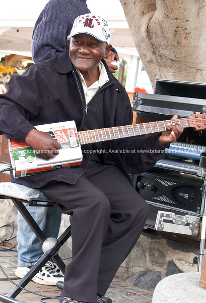 "Castrol Man, guitarist at the waterfront area of Cape Town. note the guitar.<br /> Model released; no, for editorial & personal use. SEE ALSO:  <a href=""http://www.blurb.com/b/685976-africa"">http://www.blurb.com/b/685976-africa</a>"