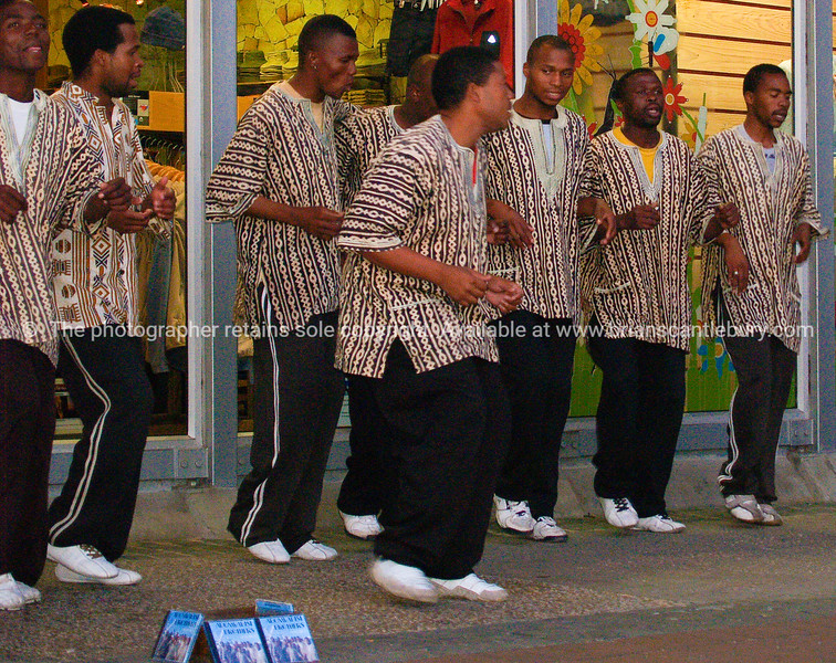 """Song and dance, busking.<br /> Model released; no, for editorial & personal use. SEE ALSO:  <a href=""""http://www.blurb.com/b/685976-africa"""">http://www.blurb.com/b/685976-africa</a>"""