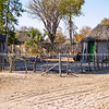 Small African village road, homes and people of Gweta Botswana