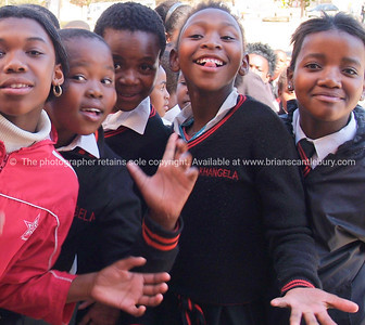 Smiling faces. A group of school kids all trying to get in the shot. Model released; no, for editorial & personal use. SEE ALSO: www.blurb.com/b/685976-africa