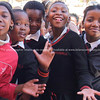 """Smiling faces. A group of school kids all trying to get in the shot.<br /> Model released; no, for editorial & personal use. SEE ALSO:  <a href=""""http://www.blurb.com/b/685976-africa"""">http://www.blurb.com/b/685976-africa</a>"""