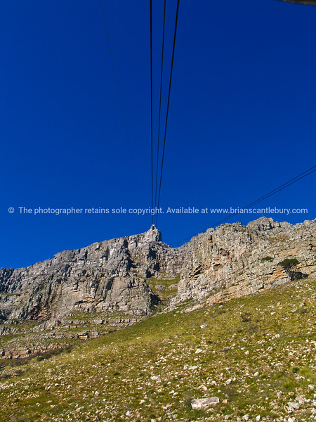 "Cable car cables heading up Table Mountain, Cape Town. SEE ALSO:  <a href=""http://www.blurb.com/b/685976-africa"">http://www.blurb.com/b/685976-africa</a>"