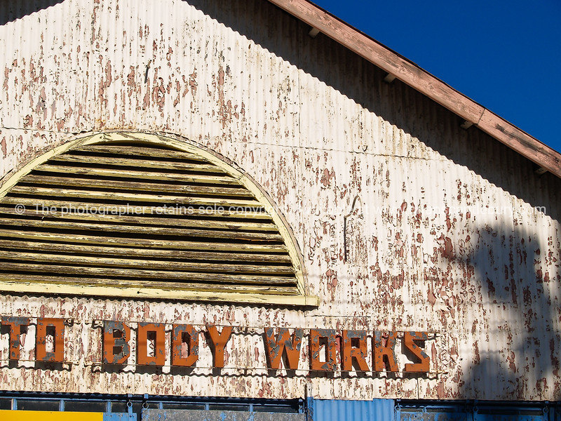 """Body works, part of an old sign on dilapidated building, Cape Town. SEE ALSO:  <a href=""""http://www.blurb.com/b/685976-africa"""">http://www.blurb.com/b/685976-africa</a>"""