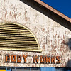 "Body works, part of an old sign on dilapidated building, Cape Town. SEE ALSO:  <a href=""http://www.blurb.com/b/685976-africa"">http://www.blurb.com/b/685976-africa</a>"