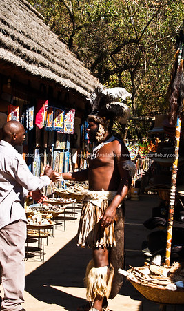 Two African meet and greet in the Lesedi market place. SEE ALSO: www.blurb.com/b/685976-africa