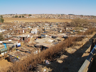 "Soweto, ""informal village"" or shanty town. SEE ALSO: www.blurb.com/b/685976-africa"