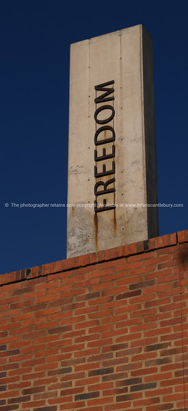 Freedom, Vertical lettering on concrete pillar. A reminder of aparthied struggle. SEE ALSO: www.blurb.com/b/685976-africa