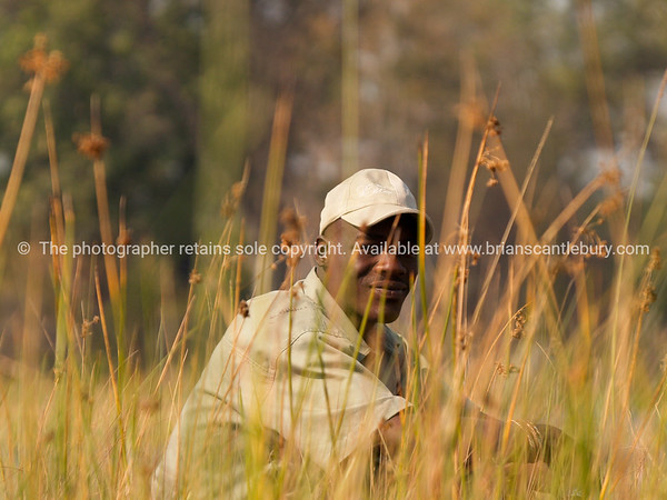 Guide sitting amongst reeds.