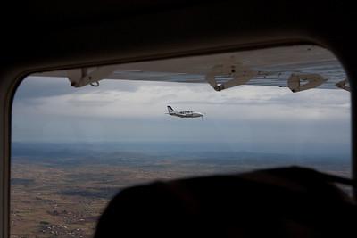 A shot of the boy's plane in flight.