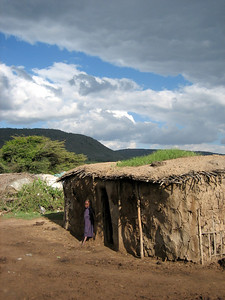 Masai house with small girl, Kenya