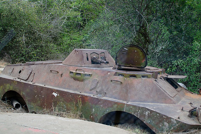 An old tank that must have guarded access to the Barra da Kuanza bridge during Angola's civil war.  It sits abandoned just past the toll booth as you approach from the North.